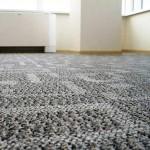 Уложенный ковролин на бетонный пол